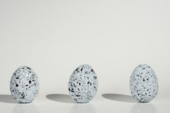 Three spotted eggs on white background Royalty Free Stock Photo