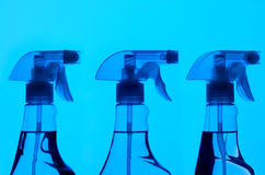 Three Spray Bottles With Blue Light Royalty Free Stock Photo