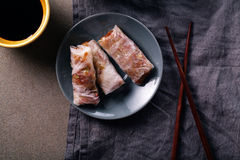 Three spring rolls with soy sauce Stock Photography