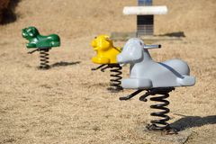 Three Spring See Saws. In a playground Royalty Free Stock Images