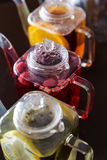 Three square teapots with fruit tastes of tea Royalty Free Stock Images