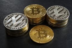 Three stack of cryptocurrency coins with single bitcoin Royalty Free Stock Images