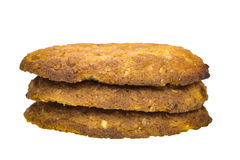 Three stack of oatmeal cookies on a white background Stock Image