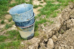 Three stacked buckets. Three stacked old buckets in the garden Royalty Free Stock Photo