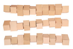 Three stacked  cardboard boxes Royalty Free Stock Photos