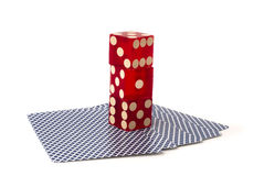 Three stacked dice on playing cards Stock Photos