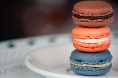 Three Stacked Macaron Cookies on White Plate royalty free stock image