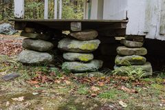 Three stacked stone house foundation piers on an old Appalachian house Royalty Free Stock Image