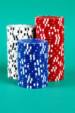 Three Stacks #2. Three stacks of poker chips against a green background Stock Photo