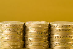 Three Stacks of British Pound Coins Stock Images