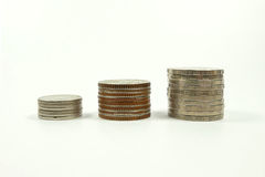 Three stacks coins isolated on white background royalty free stock photos