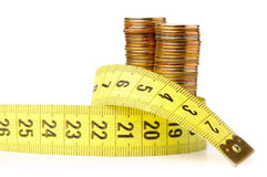 Three stacks of coins with measuring tape Stock Image