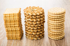 Three stacks with different cookies on table. Three stacks with different cookies on wooden table Stock Photo