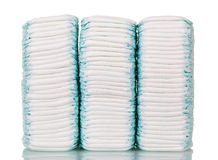 Three stacks disposable diapers isolated on white. Royalty Free Stock Photos
