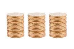 Three Stacks of Gold Coins. Three Stacks of Blank Gold Coins Isolated on White Background royalty free stock images