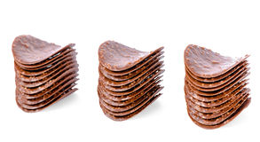 Three stacks of milk chocolate chips is isolated on white backgr Royalty Free Stock Photos