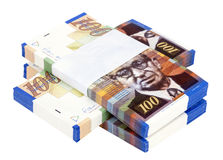 Isolated 100 NIS Bills Criss-Cross Stacks. Three stacks of 100 NIS (New Israeli Shekel) money notes on top of eachother, isolated on white background Stock Photo