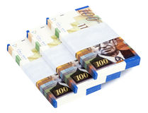 Isolated 100 NIS Bills Stacks Staircase. Three stacks of 100 NIS (New Israeli Shekel) money notes on top of eachother, spread like a staircase. Shot diagonally Royalty Free Stock Image