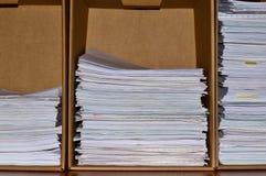Three stacks of office paperwork. stock photos