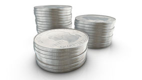 Three stacks of quarter dollar coins on white background Royalty Free Stock Photo