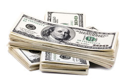 100 US$ Bills Stack. Three stacks of 100 US$ money notes on top of eachother,  on white background Royalty Free Stock Image