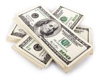 100 US$ Bills Stack. Three stacks of 100 US$ money notes on top of eachother,  on white background Royalty Free Stock Photo