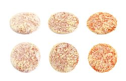 Three stages of cooking frozen pizza isolated. Over the white background, each in two foreshortenings Stock Photos