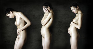 Three stages of pregnancy. naked pregnant women. Stock Photos