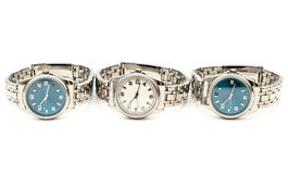Three stainless men`s wristwatches. Isolated on white background Stock Images