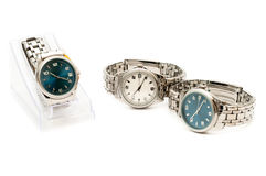 Three stainless men`s wristwatches. Isolated on white background Royalty Free Stock Photo