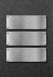 Three stainless steel metal plates Royalty Free Stock Images