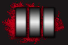 Three stainless steel vertical labels on the red smoke Stock Images