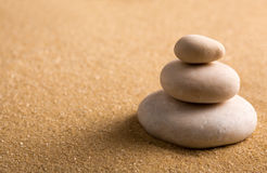 Three staked stones on sand. Zen garden. Macro of three staked stones on sand Royalty Free Stock Image