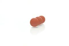 Three Standing Brown Pills Stock Photo