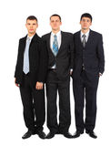 Three standing young businessmen Stock Photos