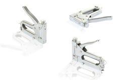 Three staple guns. At white; background Royalty Free Stock Photo