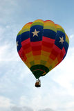 Three Star Balloon. Three stars can be seen on this hot air balloon soaring in the sky. Also, on the left side of this balloon there are American and Texas flags stock photos