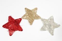Three stars. Three straw stars on white Royalty Free Stock Photo