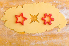 Three stars in cookie dough. Three different stars shapes in raw cookie dough Royalty Free Stock Images
