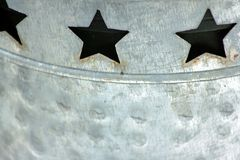 Three Stars cut out in a tin can with a horizontal Royalty Free Stock Photo
