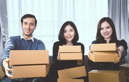 Three start up business partner holding delivery boxes ready to send out to customer Stock Photos