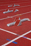 Three Starting Blocks Athletic. Athletics Starting Blocks and red running tracks in a stadion Royalty Free Stock Photos