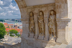 Three statues of guardians in Budapest, Hungary. BUDAPEST, HUNGARY - JUNE 9, 2016: Three statues of guardians are standing under the arch of Fisherman Bastion in Stock Image