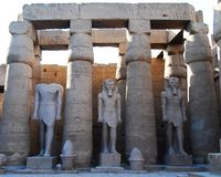 Three statues in the temple of Luxor stock image