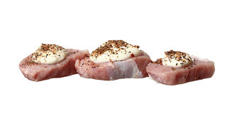 Three steaks raw meat with mayonnaise and spices Stock Image