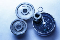 Three steel cogwheels with compass Royalty Free Stock Image