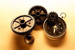 Three steel cogwheels with compass Stock Photos