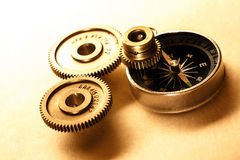 Three steel cogwheels with compass Royalty Free Stock Photography