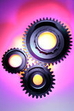 Three steel gears Stock Photos