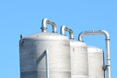 Three steel tanks with sky Royalty Free Stock Images